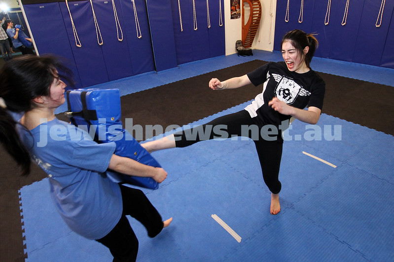 11-6-12. Krav Maga instructor Melinda Slonim demonstrating a front kick during a women's session. Photo: Peter Haskin