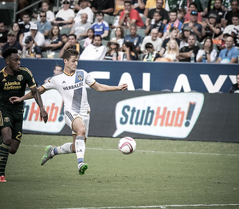 Robbie Rodgers of the LA Galaxy dribbles down the field.
