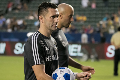 Robbie Keane signs autographs after the game.