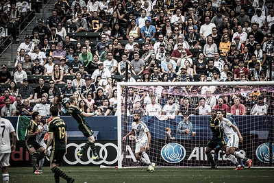 The crowd freezes and Borchers and his beard try to score a header on the LA Galaxy. I love the crowd expressions that get captured in sporting events.