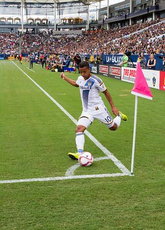 Dos Santos of the LA Galaxy takes a corner kick at Stub Hub Center.
