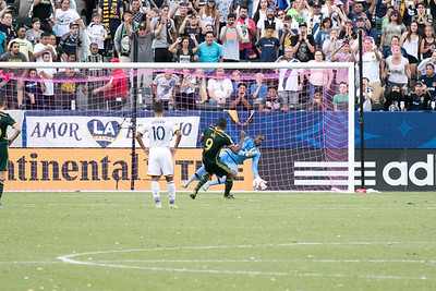 Los Angeles Galaxy Star Giovani Dos Santos looks on as Portland scores a penalty kick. The fans on the right were not happy.