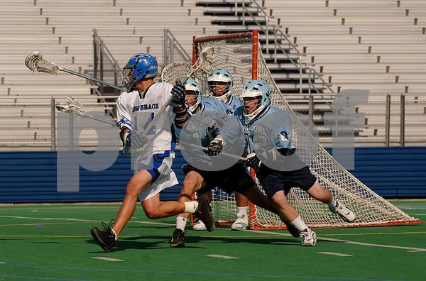 #14 LB Max Weisenberg, Junior, one goal, Oceanside, #11 Steve Pryor, #12 Sean Regan, Goalie #13 John Bella. May 22, 2007. Photo by Kathy Leistner