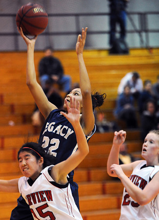 20120103_Fairview_Legacy_WBBall_9.jpg Legacy's Kailey Edwards drives through Fairview's Betty Yi, left, on her way to the hoop during the third quarter of their Tuesday, January 3, 2012 game hosted by the Knights. (Kira Horvath/Daily Camera)