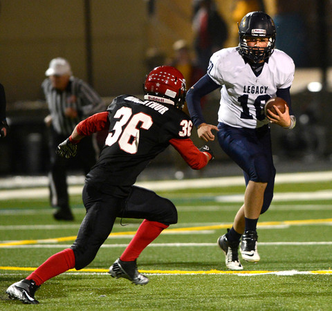 """Fairview High School's #36 Aaron MacArthur tracks down Legacy High School's #10 Steven Yoshihara during their game at Recht Field on  October 12, 2012. For more photos go to  <a href=""""http://www.bocopreps.com"""">http://www.bocopreps.com</a><br /> Photos by Paul Aiken / The Boulder Camera"""