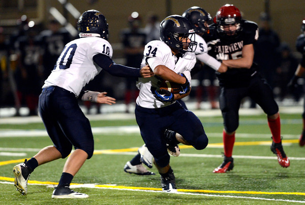 """Legacy High School's #34 Phydell Paris takes the hand off from #10 Steven Yoshihara during their game against Fairview High at Recht Field on  October 12, 2012. For more photos go to  <a href=""""http://www.bocopreps.com"""">http://www.bocopreps.com</a><br /> Photos by Paul Aiken / The Boulder Camera"""