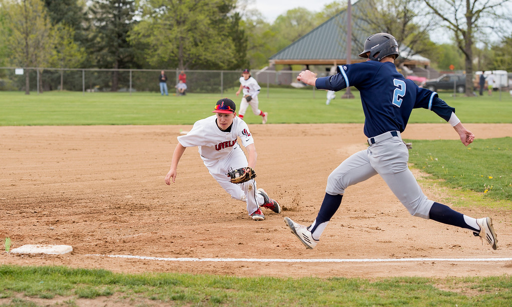 . Loveland\'s Jackson Bakovich (5) races Ralston Valley\'s Peter Carlson (2) back to third base after making a catch for an out Tuesday afternoon May 10, 2016, at Centennial Park in Loveland. (Photo by Michael Brian/Loveland Reporter-Herald)