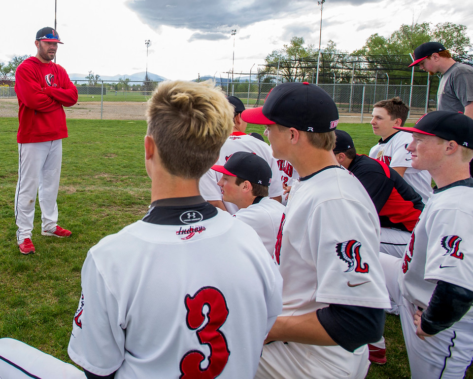 . Loveland head baseball coach Jerod Cronquist addresses the team after a 7-0 to Ralston Valley Tuesday afternoon May 10, 2016 at Centennial Park in Loveland. (Photo by Michael Brian/Loveland Reporter-Herald)