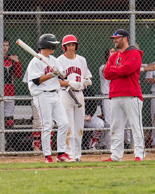 . Loveland head baseball coach Jerod Cronquist, right, talks to Jordan Cabrera (9), left, and Keegan Villarreal (31), center, during a timeout Tuesday afternoon May 10, 2016 at Centennial Park in Loveland. (Photo by Michael Brian/Loveland Reporter-Herald)