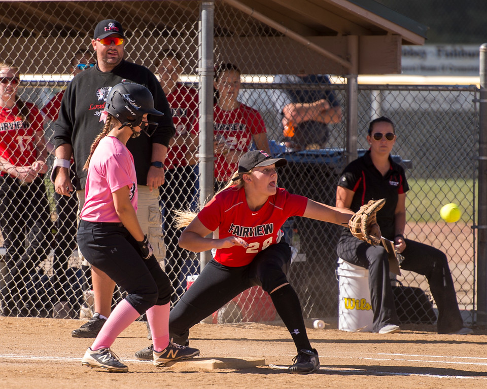 . Loveland\'s Addi Woodard (3) gets back to the bag before the putout throw reaches Fairview first baseman Faith Anderson (28) Saturday morning Oct. 8, 2016 at Centennial Park in Loveland. The Indians were in control the whole game, winning 7-0. (Photo by Michael Brian/Loveland Reporter-Herald)