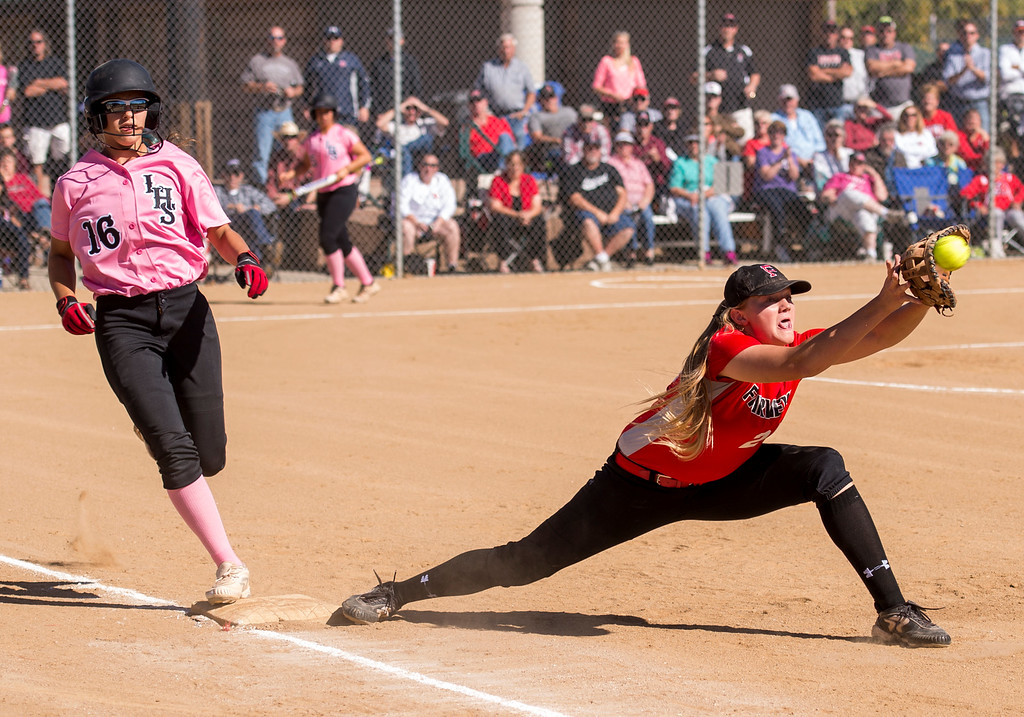 . Loveland pitcher Laurin Krings (16) just beats the putout throw to Fairview first baseman Faith Anderson (28) Saturday morning Oct. 8, 2016 at Centennial Park in Loveland. The Indians won in a 7-0 shutout. (Photo by Michael Brian/Loveland Reporter-Herald)