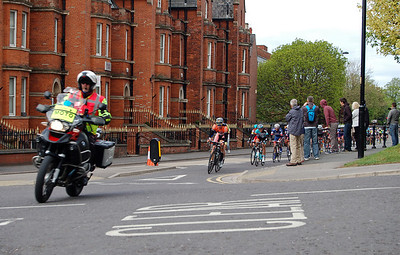 On the first lap the peleton races by the Police Station, getting ready for the big climb