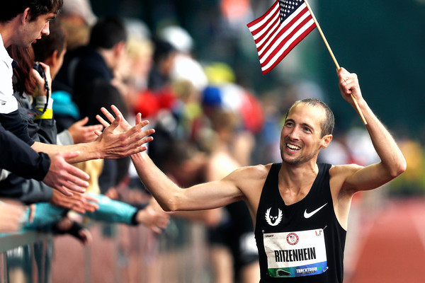 AP120622152169.jpg Dathan Ritzenhein reacts after finishing the men's 10,000m finals at the U.S. Olympic Track and Field Trials Friday, June 22, 2012, in Eugene, Ore. Galen Rupp finished first, Matt Tegenkapm second and Ritzenhein third. The three will represent the U.S. in the London Olympics.  (AP Photo/Charlie Riedel)<br /> olympics