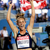AP110901025657x.jpg USA's Jennifer Barringer Simpson celebrates winning gold in the Women's 1500m final at the World Athletics Championships in Daegu, South Korea, Thursday, Sept. 1, 2011. (AP Photo/David J. Phillip)<br /> olympics