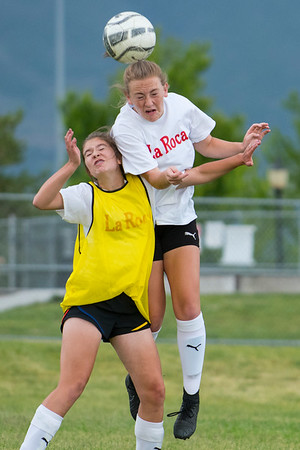 Shea Chritiansen (772) heads the ball as team mate battles her for the ball during the Soccer tryouts for La Roca. La Roca is a club soccer program based in Northern Utah that is now an academy. At Ellison Park in Layton on Thursday June 2, 2017.