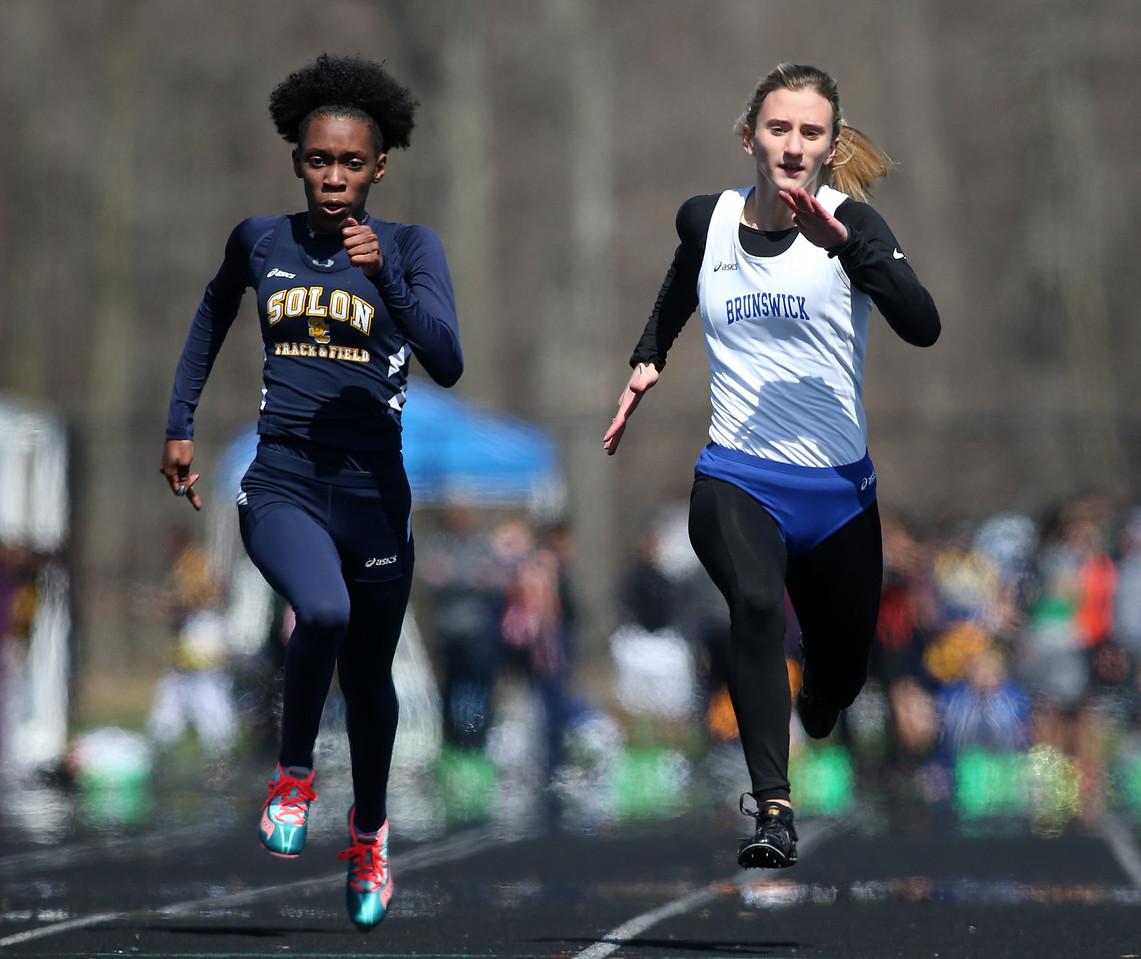 Brunswick's Bailey Lack outruns Solon's Allison Vason to win the 100 meter dash at the Brunswick Elite meet on Saturday. AARON JOSEFCZYK/GAZETTE