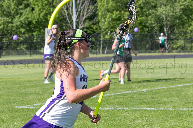 Marshwood's Paige Singer looks to pass the ball during the Class A South Lacrosse Final held at Marshwood High School Wednesday. Photo by Scott Patterson/Fosters.com