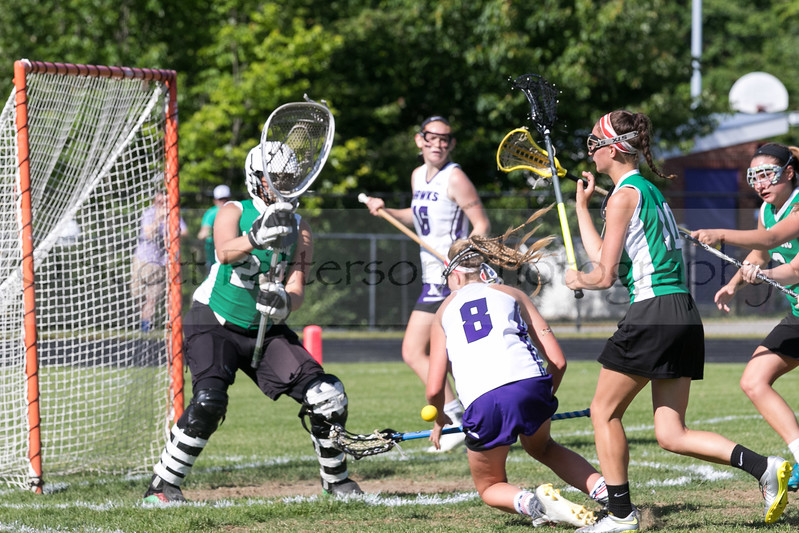 Marshwood's Reagan Nichols charges hard to the net while Massabesic's Lydia Wasina and Josie Ring defend during the Class A South Lacrosse Final held at Marshwood High School Wednesday. Photo by Scott Patterson/Fosters.com