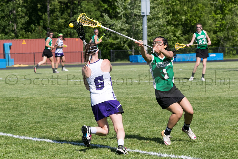 Massabesic's Delia Sylvain nocks the ball lose from Marshwood's Hannah Costin during  the Class A South Lacrosse Final held at Marshwood High School Wednesday. Photo by Scott Patterson/Fosters.com