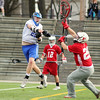 Leominster High School boys' lacrosse played Hudson at Doyle Field on Tuesday afternoon. LHS's Tyler Cuddahy fires a shot on Hudson's goal by a defender during action in the game. SENTINEL & ENTERPRISE/JOHN LOVE