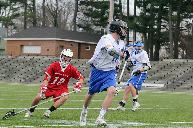 Leominster High School boys' lacrosse played Hudson at Doyle Field on Tuesday afternoon. LHS's Adam Leger takes control of the ball during action in the game. SENTINEL & ENTERPRISE/JOHN LOVE