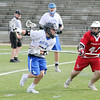 Leominster High School boys' lacrosse played Hudson at Doyle Field on Tuesday afternoon. A Hudson defender tries to stop LHS's Andrew Bouchard during action in the game. SENTINEL & ENTERPRISE/JOHN LOVE