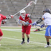 Leominster High School boys' lacrosse played Hudson at Doyle Field on Tuesday afternoon. Among a bunch of Hudson defenders LHS's Hector Delgado fires a shot on goal. SENTINEL & ENTERPRISE/JOHN LOVE