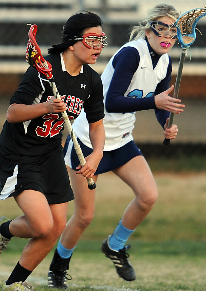 The Mann Patriots played host to the Hillcrest Rams in Lacrosse matches.<br /> GWINN DAVIS PHOTOS<br /> gwinndavisphotos.com (website)<br /> (864) 915-0411 (cell)<br /> gwinndavis@gmail.com  (e-mail) <br /> Gwinn Davis (FaceBook)
