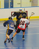 """Onondaga Redhawks Brett Bucktooth (66) shoots and scores against the Allegany Arrows in Can-Am Senior """"B"""" Box Lacrosse league action at the Onondata Nation Arena in Nedrow, New York on Sunday, June 26, 2011.  Redhawks won 30-4."""