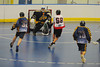 "Onondaga Redhawks Brett Bucktooth (66) shoots and scores as Allegany Arrows defender Keaton Lazore (32) gives chase in Can-Am Senior ""B"" Box Lacrosse league action at the Onondaga Nation Arena in Nedrow, New York on Sunday, June 26, 2011.  Redhawks won 30-4."