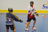 "Onondaga Red Hawks Grant Bucktooth (15) looks to make a play against Allegany Arrows defender Jeremiah Bova (24) in Can-Am Senior ""B"" Box Lacrosse league action at the Onondaga Nation Arena in Nedrow, New York on Sunday, June 26, 2011.  Redhawks won 30-4."