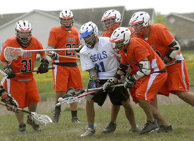 Selinsgrove's Ian Garlock moves the ball away from a mass of Tuckhannock players during their game Saturday April 21, 2012 in Selinsgrove.