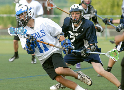 Selinsgrove's Ian Garlock manuvers around Mifflinburg's Chaz Mytinger during their semi-final game Tuesday May 15, 2012 at Susquehanna University in Selinsgrove.
