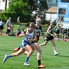 Freshman Meagan Parlee races the ball down field as Grafton's Brittany McManus defends. Nashoba Publishing/Ed Niser