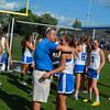 First-year Bromfield head coach Dave Planchet embraces senior defender Marcy Schappe after Saturday's win.                            Nashoba Publishing/Ed Niser