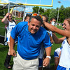 Bromfield players cool off had coach Dave Planchet during Saturday's Central/Western Mass Championship celebration at Foley Stadium in Worcester. Nashoba Publishing/Ed Niser
