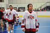 "Onondaga Redhawks A. J. Bucktooth (18) waiting to shake hands with the Newtown Golden Eagles after winning the Can-Am Senior ""B"" Box Lacrosse finals at the Onondaga Nation Arena near Nedrow, New York."