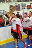 "Onondaga Redhawks Neal Powless (16) parading the Stanley ""Butch"" Jimerson Can-Am Lacrosse Champions Cup around the Onondaga Nation Arena near Nedrow, New York."
