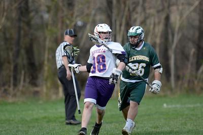 Danville's Austin Lucas tries to fend off Lewisburg's Alex Liscum during Tuesday's lacrosse match.