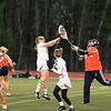 FSU Ali Laferriere attepmts to stop the goalie from sending out the ball