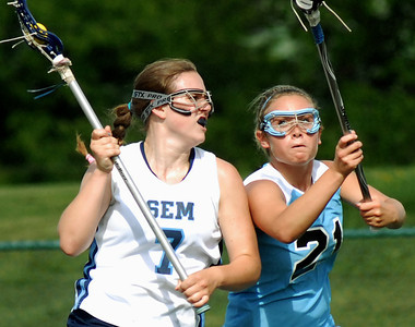 Midd-West's Nicole Horst keeps her defence tight against Wyoming Seminary's Kristen Mericle during their game Tuesday May 22, 2012 at Susquehanna University.