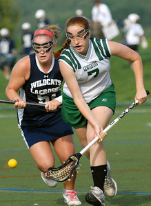 Mifflinburg's Dani Ard and Lewisburg's Hanna Gotoff race for control of the ball during their semi-final game Tuesday May 15, 2012 at Susquehanna University in Selinsgrove.