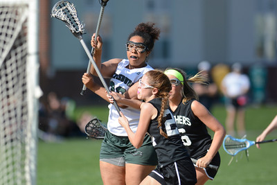 Lewisburg's Eze Amaka takes a shot on goal during Wednesday's lacrosse game against Central Dauphin East.