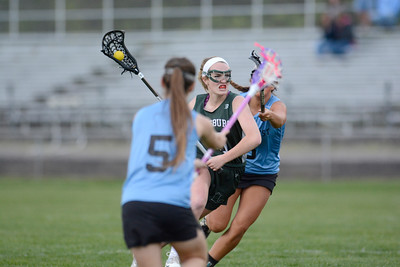 Lewisburg's Kat Gardner looks for an opening in the Midd-West defense during Tuesday's game at Midd-West.