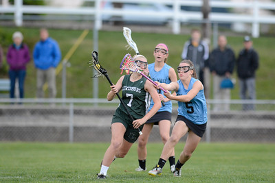 Lewisburg's Olivia Reish runs through the stick of Midd-West's Alyssa Keister during Tuesday's game.