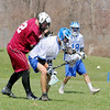 Fitchburg High School boy's lacrosse played Lunenberug High School on Tuesday April 22, 2014 at LHS. FHS's Hunter Sallila and LHS's Dylan Riley fight for control of the ball during action in the game. SENTINEL & ENTERPRISE/JOHN LOVE