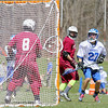Fitchburg High School boy's lacrosse played Lunenberug High School on Tuesday April 22, 2014 at LHS. LHS's Dustin Powell watches his shot on FHS's goalie Johny Xiong during action in the game. SENTINEL & ENTERPRISE/JOHN LOVE