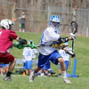 Fitchburg High School boy's lacrosse played Lunenberug High School on Tuesday April 22, 2014 at LHS. FHS's Alfred Allen tries to stop LHS's Michael LaManna during action in the game. SENTINEL & ENTERPRISE/JOHN LOVE