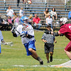 Fitchburg High School boy's lacrosse played Lunenberug High School on Tuesday April 22, 2014 at LHS. FHS's Steven Bertemello tries to stop LHS's Dylan Riley as he looks for an open teammate to pass too during action in the game. SENTINEL & ENTERPRISE/JOHN LOVE