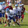 Fitchburg High School boy's lacrosse played Lunenberug High School on Tuesday April 22, 2014 at LHS. As many fight for control of the ball LHS's Nicholas Marino scoops it up. LHS's SENTINEL & ENTERPRISE/JOHN LOVE